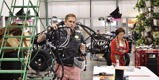 Jay shows the wire harness for the Local Motors Rally Fighter